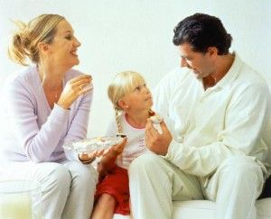 Young Family Eating Chocolates